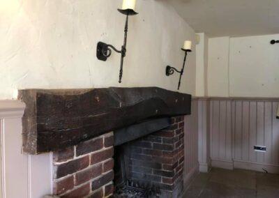 pub fireplace beam restoration before